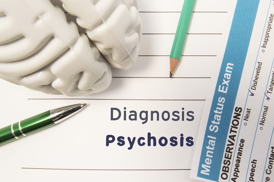 Diagnosis and Psychosis written on notebook paper