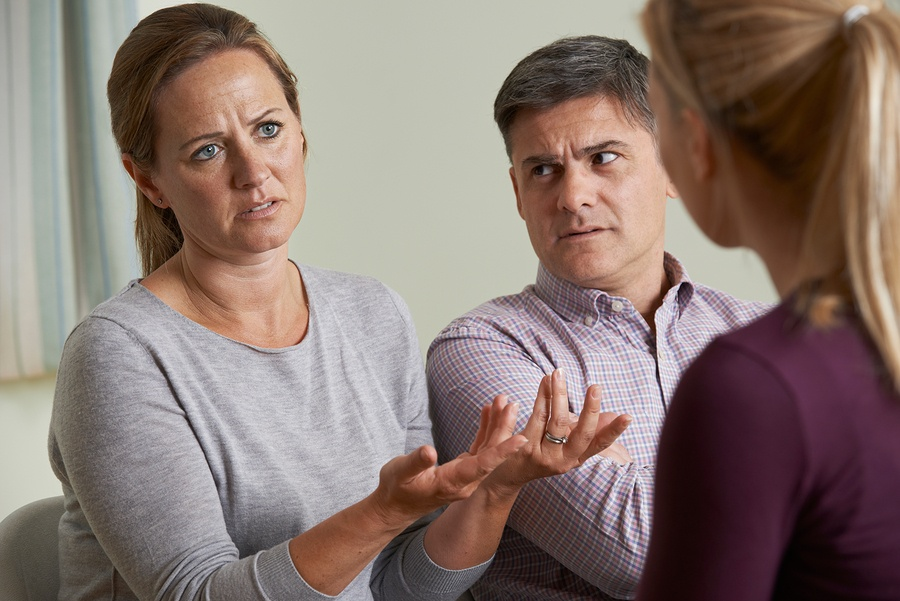 bigstock-Couple-Discussing-Problems-Wit-105454238