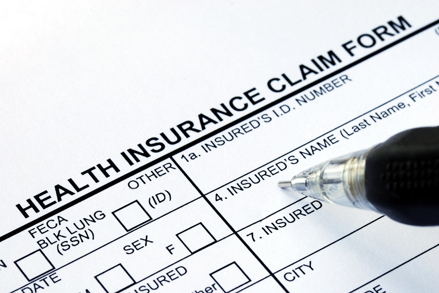 Filling out health insurance claim form
