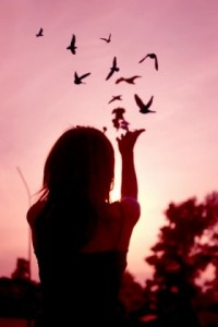 Woman releasing doves