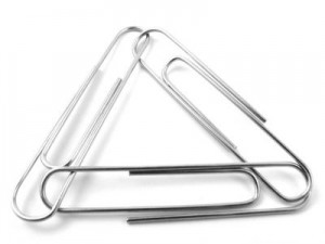Three paper clips forming a chain